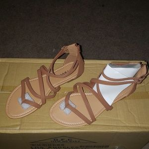 Women's strappy buckle accent zip heel flat sandal